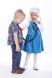 Little girl and boy playing with stethoscope Royalty Free Stock Photography