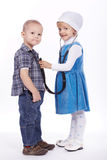 Little girl and boy playing with stethoscope Royalty Free Stock Photos