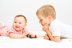 Little girl and boy playing with toys Stock Photography