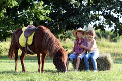 Little girl and boy with pony horse Stock Photography