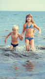 Little girl and boy in the sea Royalty Free Stock Photo