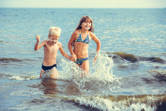 Little girl and boy in the sea Royalty Free Stock Images