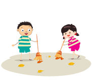 Little girl and boy sweeping Stock Photo