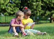 Little girl and boy with tablet Stock Photography