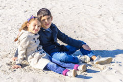 Little girl and boy together on beach Stock Images