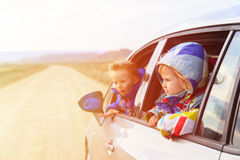 Little girl and boy travel by car on the road Royalty Free Stock Photography