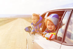 Little girl and boy travel by car on the road Royalty Free Stock Photo