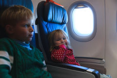 Little girl and boy travel by plane. Family travel Royalty Free Stock Photography