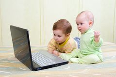 Little girl and boy using laptops. Stock Images