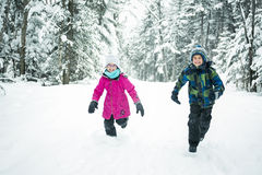 Little girl and boy in winter season Royalty Free Stock Photos