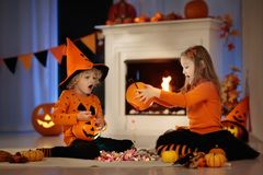 Kids in witch costume on Halloween trick or treat stock photography