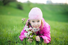 Little girl with branch of flowers Royalty Free Stock Photography