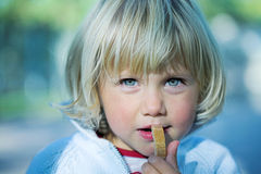 Little girl with bread royalty free stock images