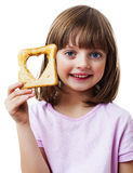 Little girl with bread - heart symbol Stock Photos
