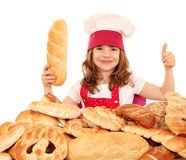 Little girl with bread and thumb up Royalty Free Stock Photography