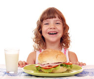 Little girl with breakfast Royalty Free Stock Photos