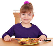 Little girl with breakfast Stock Images