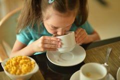 little girl at breakfast Stock Photo