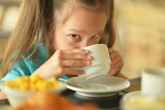 Little girl at breakfast Royalty Free Stock Images
