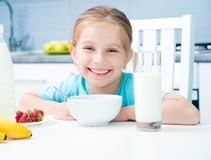 Little girl at the breakfast Stock Photo