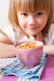 Little girl in breakfast table Royalty Free Stock Photo