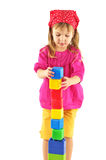 Little girl with bricks Stock Photography