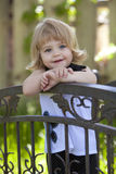 Little girl on bridge Stock Images