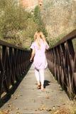 Little girl on bridge Stock Photo