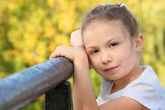 Little girl on a bridge in early fall park Royalty Free Stock Images