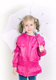 Little girl in bright coat. Stock Images