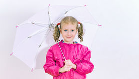 Little girl in bright coat. Royalty Free Stock Image