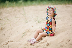 Little girl with bright colorful dress Stock Images
