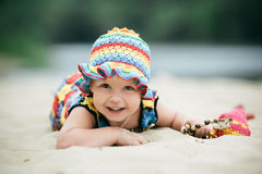 Little girl with bright colorful dress Stock Photos