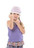 Little Girl in Bright Dress Shows Fists Royalty Free Stock Photo