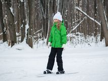 Girl fun skiing through the winter forest. royalty free stock photography