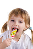 Little girl with a bright lollipop royalty free stock image
