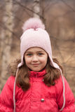 Little Girl In Bright Red Jacket And Knitted Pink Cap On Spring stock photos