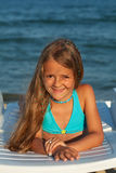 Little girl in bright sunshine at the seaside Royalty Free Stock Photography