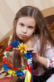 Little girl with a bright wreath Royalty Free Stock Images