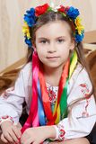 Little girl with a bright wreath Royalty Free Stock Photos
