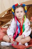 Little girl with a bright wreath Stock Photography