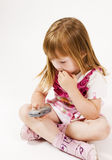 Little girl is brooding Royalty Free Stock Photography