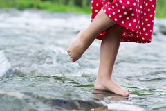 Little girl in the brook Royalty Free Stock Image