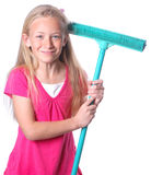 Little girl with broom. Portrait of a cute little Caucasian preteen girl child with happy smiling facial expression holding a green broom in her hands ready for stock images