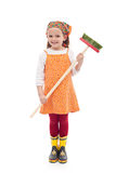Little girl with broom and rubber boots royalty free stock photography