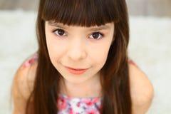 Little girl brown eyes Stock Photo