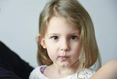Little girl pouting stock photos