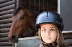 Little girl and brown Horse Royalty Free Stock Photography