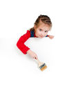 Little girl with a brush and white banner Royalty Free Stock Photography