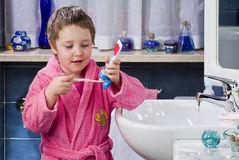Little girl brushes her teeth Royalty Free Stock Photo